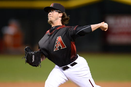 Arizona Diamondbacks relief pitcher Zac Curtis pitches during the ninth inning against the Colorado Rockies on April 30, 2016. It was his major league debut.