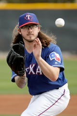 Pitcher Zac Curtis fields a ball during spring training Feb. 13, 2019, in Surprise, Ariz.