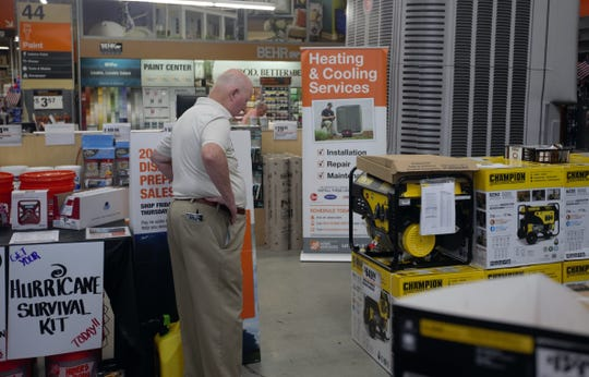 Michael Ellert browses prices for small generators at Home Depot on Sunday, June 2, 2019.