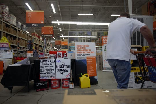 Home Depot advertises the hurricane sales tax holiday to shoppers with flyers and rows of generators.