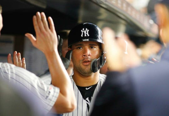 New York Yankees catcher Gary Sanchez (24) is congratulated after hitting a two run home run against the Boston Red Sox during the fifth inning at Yankee Stadium.