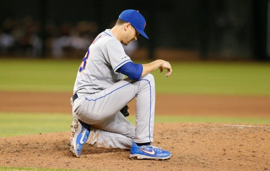 Jun 1, 2019; Phoenix, AZ, USA; New York Mets starting pitcher Jacob deGrom (48) reacts after throwing a pitch against the Arizona Diamondbacks in the seventh inning during a baseball game at Chase Field.