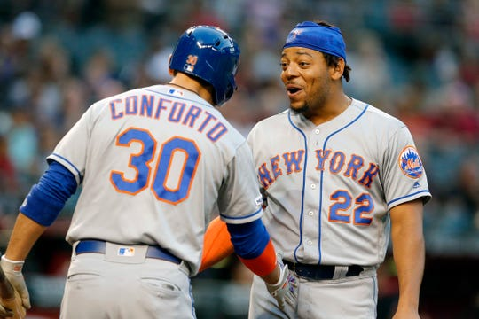 Jun 1, 2019; Phoenix, AZ, USA; New York Mets first baseman Dominic Smith (22) celebrates with Michael Conforto (30) after scoring a run against the Arizona Diamondbacks in the first inning during a baseball game at Chase Field.
