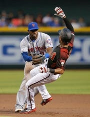 Jun 1, 2019; Phoenix, AZ, USA; New York Mets second baseman Adeiny Hechavarria (11) tags out Arizona Diamondbacks center fielder Jarrod Dyson (1) in the first inning during a game at Chase Field.