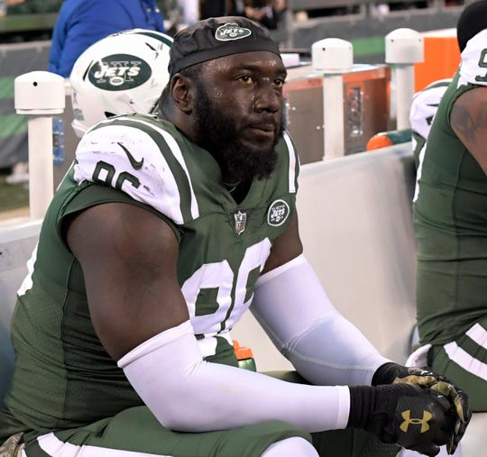 In this Nov. 26, 2017, file photo, New York Jets defensive end Muhammad Wilkerson sits on the bench during the second half of an NFL football game against the Carolina Panthers, in East Rutherford, N.J. Former New York Jets defensive end Wilkerson is charged with driving while intoxicated after his arrest in New York City. A police spokesman says Wilkerson was arraigned Saturday, June 1, 2019,  in Manhattan Criminal Court and released on his own recognizance.