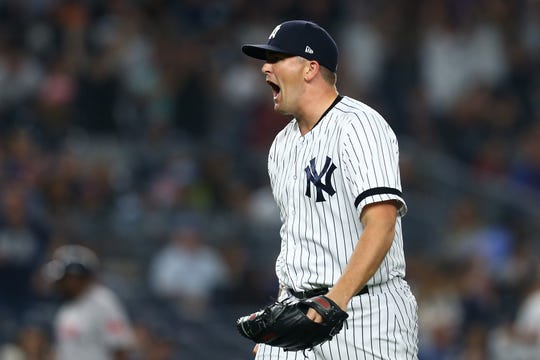 Jonathan Holder #56 of the New York Yankees reacts after getting the third out of the top of the seventh inning against the Boston Red Sox at Yankee Stadium on June 1, 2019 in New York City.