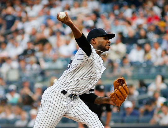 Jun 1, 2019; Bronx, NY, USA; New York Yankees starting pitcher Domingo German (55) pitches against the Boston Red Sox during the first inning at Yankee Stadium.