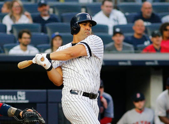 Jun 1, 2019; Bronx, NY, USA; New York Yankees designated hitter Kendrys Morales (36) singles against the Boston Red Sox during the second inning at Yankee Stadium.