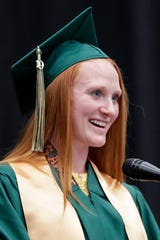 Syd Supple gives the student address during Oshkosh North High School's graduation ceremony at the Menominee Nation Arena on Sunday in Oshkosh.