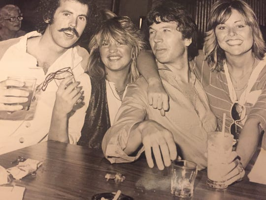Bruce Fessier (at left) hanging out at the historic Racquet Club in the early 1980s with some friends whose names somehow have managed to escape him.