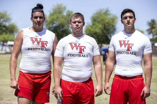 Williams Field's Andrew Garcia, Cooper Darling, and Noah Nelson pose for a portrait during the Chandler Big Man Football Challenge on Saturday, June 1, 2019, at Chandler High School in Chandler, Ariz.