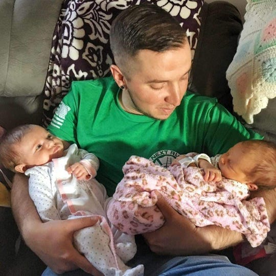 John 'JD' Smith holding his two nieces, Avery and Serenity. Smith, who was a volunteer firefighter in Red Lion, died in a motorcycle crash June 1.