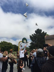 Families released doves into the sky signifying peace and love while honoring their loved ones.