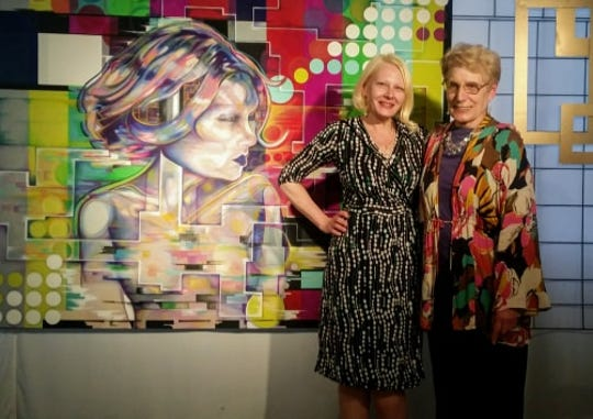 Golden Frame Awards winners Kay Jelinek and Kimberly Nysse pose in front of Nysse's winning piece.
