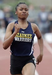 Ozaukee's Delanie McFadden wins the Division 3 200 meters during the WIAA state track and field meet Saturday at Veterans Memorial Field Sports Complex in La Crosse.