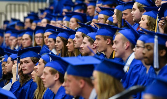 Graduates listen to instructions before the start of  Sartell High School's graduation ceremony Saturday, June 1, in Sartell.