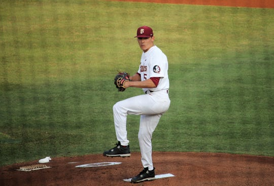 C.J. Van Eyk pitches during FSU baseball's game against Georgia in the Athens Regional.