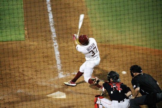 FSU left fielder Tim Becker hits during FSU baseball's game against Georgia in the Athens Regional.
