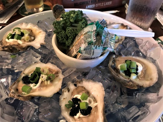 Pineapple Joe's dirty oysters on the half shell were sublime with sour cream and salty caviar.