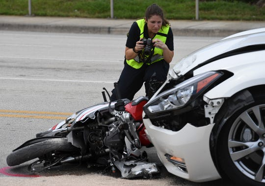 City of Stuart Police officers investigate a traffic crash involving a motorcycle and a car along the 2100 block of East Ocean Boulevard, east of the intersection with Monterey Road on Sunday, June 2, 2019 in Stuart.