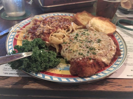Pineapple Joe's chicken parmesan and pasta was swathed in a peppery tomato sauce.