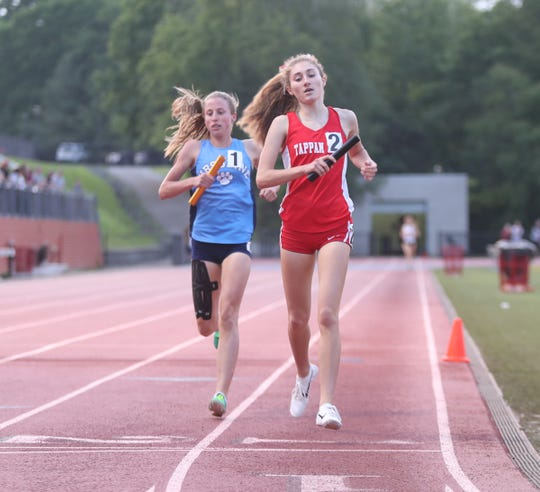 Tappan Zee's Tori Fears crosses the finish line in the 4x800-meter relay just ahead of Ursuline's Lily Flynn during day 2 of the Section 1 state Track & Field qualifier  at White Plains High School in White Plains on Saturday, June 1, 2019.