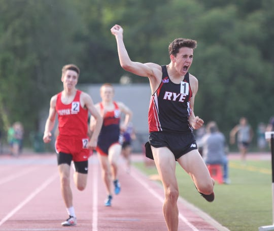 Rye's Cian Galligan crosses the finish line in the 1600-meter run with a time of 4:15.27 during day 2 of the Section 1 state Track & Field qualifier  at White Plains High School in White Plains on Saturday, June 1, 2019.