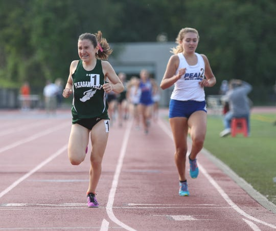 Pleasantville's Adriana Catalano edges out Pearl River's Mary Borkoski in the 1500-meter run during day 2 of the Section 1 state Track & Field qualifier  at White Plains High School in White Plains on Saturday, June 1, 2019.