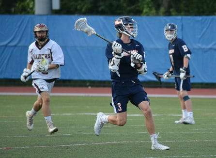 Briarcliff attackman Charlie Boyar keeps the ball moving in the second half of the Bears' 14-1 win over O'Neill on June 1, 2019 at Middletown High School.