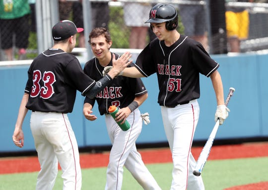 From right, Nyack's Julian Brooks' (51) celebrates after scoring in the 6th inning against Nyack in the Section 1 Class A championship at Pace University in Pleasantville June 1,  2019. Nyack went on to win the game 2-0.