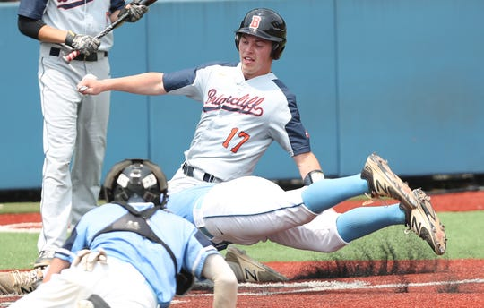 Briarcliff's Mike Hardy is tagged out at the plate by a diving Briarcliff pitcher Thomas Iazzetta (5) after Hardy tried to score from third on a wild pitch in the Section 1 Class B championship at Pace University in Pleasantville June 1,  2019. Westlake won the game 5-4 in extra innings.