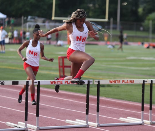 North Rockland's Torre Inzar clears a hurdle during the 400-meter girls Division 1 race during day 2 of the Section 1 State Track & Field Qualifier at White Plains High School on Saturday, June 1, 2019.