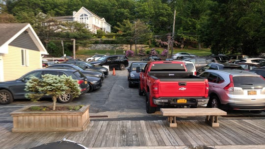 Twenty-three cars were parked on June 1, 2019  atop the area where Blu restaurant's leaching field is located.