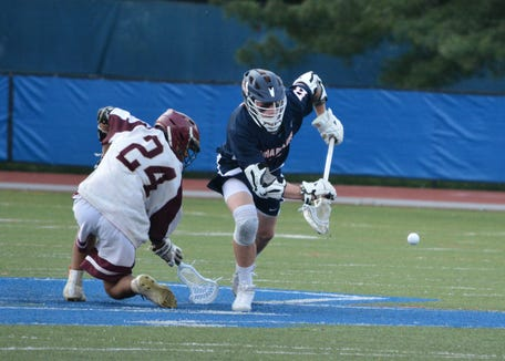Briarcliff FOGO Mike Donoghue wins a third-quarter face-off on June 1, 2019 at Middletown High School, helping the Bears move on to a NYSPHSAA semifinal.