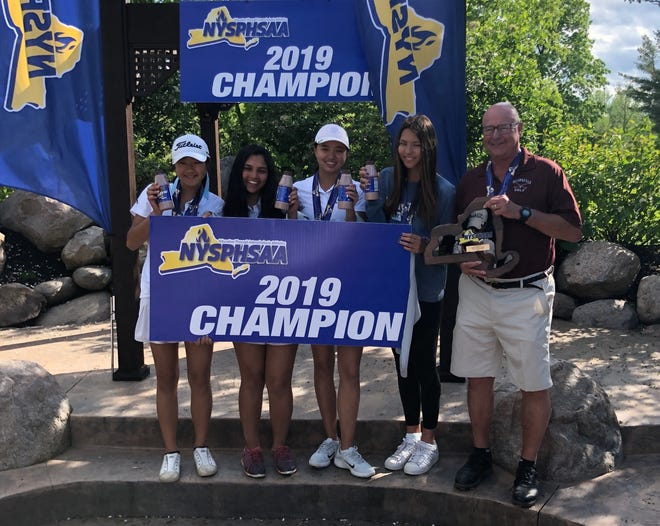Scarsdale's Kaitlyn Lee, Jacqueline Lu,Rebecca Maude and Madhavi Shashank, pictured with Raiders coach Barney Foltman, won the NYSPHSAA team championship on June 2, 2019 at Deerfield Golf and Country Club.