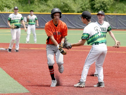 James Galati of Tuckahoe is tagged out by Harry Alfine of Solomon Schechter after being caught in a rundown during the Section 1 Class C baseball championship at Pace University June 2, 2019. Tuckahoe defeated Solomon Schechter 12-3 to sweep the best of three series.