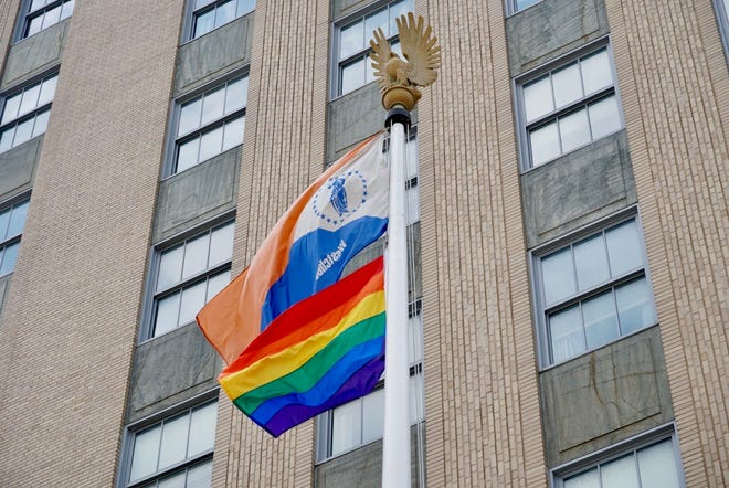 An LGBTQ pride flag is flown with the Westchester County flag in front of the county office building in White Plains, June 2, 2019.