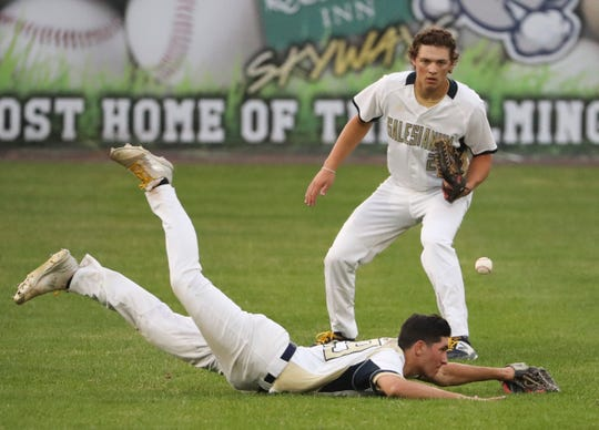 A fly ball drops in for a hit between Salesianum's Brendan Pacheco (bottom) and Joseph Sheets for an RBI in the Bucs' three-run third inning in Caravel's 5-1 win in a DIAA Baseball Tournament semifinal Saturday at Frawley Stadium.