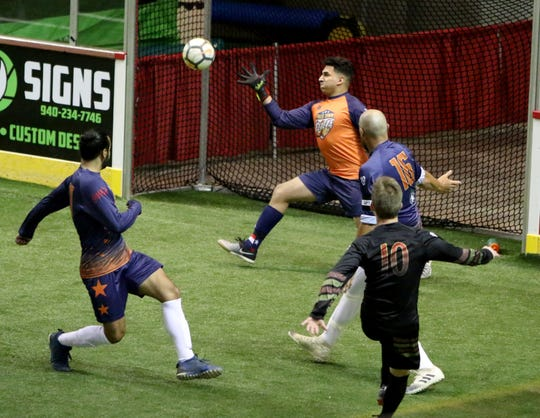 Falls Town Flyers goalie Carlos Gonzalez makes a save in a recent indoor soccer game. Gonzalez played forward at Wichita Falls High School, but now he's stopping shots instead of taking them.