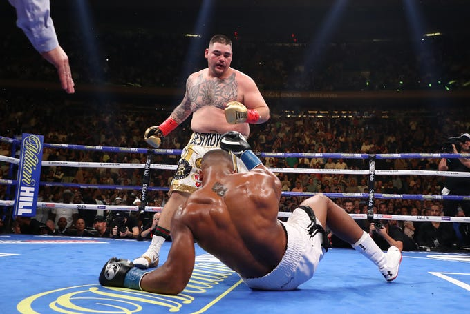 Andy Ruiz Jr. knocks down Anthony Joshua in the first round.