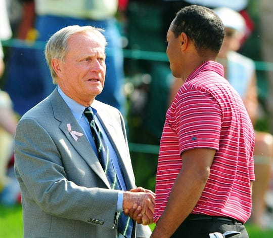 Tiger Woods, right, shakes hands with Jack Nicklaus at the 2009 Memorial.
