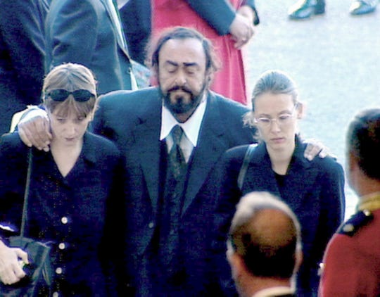 A grieving Luciano Pavarotti, supported by his future wife Nicoletta Mantovani (right) and an unidentified friend as they arrive at Westminster Abbey for the funeral of Princess Diana.