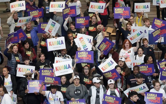Supporters of Democratic presidential candidate Sen. Kamala Harris, D-Calif., hold up signs during the 2019 California Democratic Party State Organizing Convention in San Francisco, Saturday, June 1, 2019.