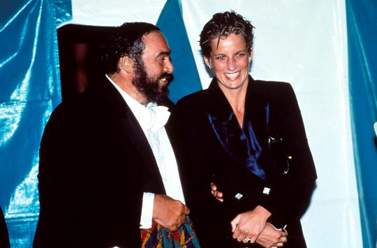 Luciano Pavarotti with Princess Diana after his famed 1991 concert in Hyde Park, where the tenor serenaded a rain-soaked princess.
