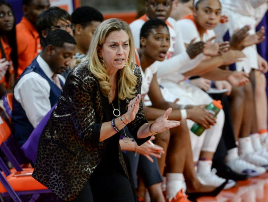 Clemson women's basketball coach Amanda Butler communicates with her team while playing against Georgia Tech.