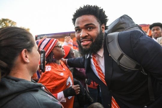In this 2018 photo, Clemson defensive lineman Christian Wilkins meets fans during Clemson Tiger Walk before kickoff of the South Carolina at Clemson football game.