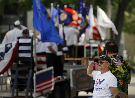 Bill Stegert of Appleton salutes during the Appleton Flag Day Parade in 2018.
