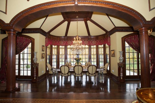 The gracious dining room offers french doors and beamed ceilings.