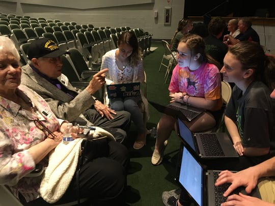 David Scheinhartz of Middletown, who served in World War II, speaks with Raritan High School students as part of the school's Veterans Portrait Project.