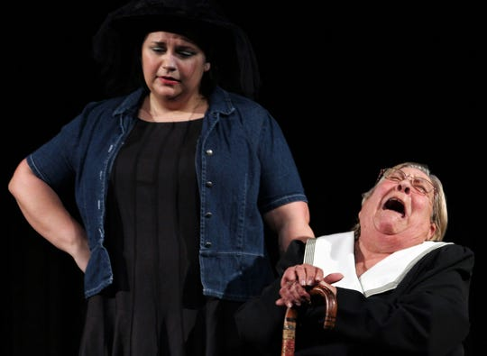 """Marguerite (Karen Reese) wails in grief at Bud Turpin's casket, while Suzanne (Kendra Brown) stands by in this rehearsal scene from """"Dearly Departed,"""" Abilene Community Theatre's 2018-19 season-ending production this weekend."""
